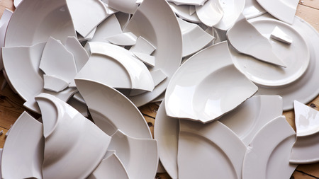 many white broken plates on a wooden floor Stock Photo - 84717627