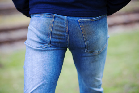 closeup of man s butt in dirty jeans walking outside