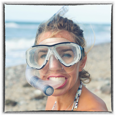 portrait of beautiful blond woman with swimming goggles on the beach Stock fotó