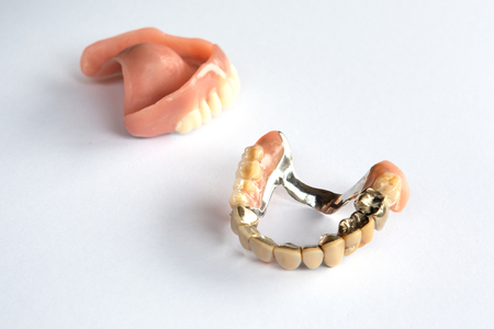 closeup of dental prosthesis on a white background Banque d'images - 106139666