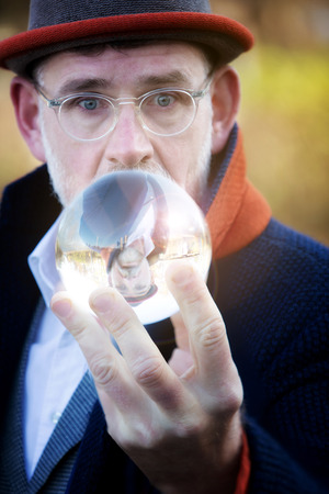 handsome mature businessman looking at a glass sphere Stock Photo
