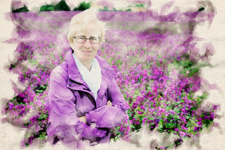 older woman standing in front of purple flowers in watercolors Banque d'images