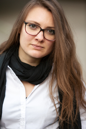 Portrait of young brunette woman wearing eyeglasses