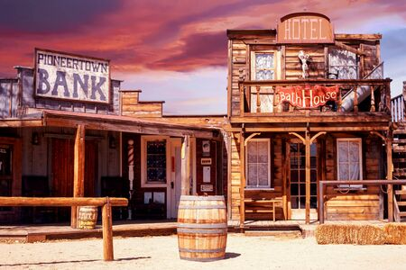 colorful view of old western pioneer town at sunset