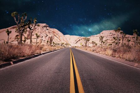 lonely road in the desert on a starry night in California