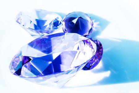 Close-up of blue shiny diamonds on white background Фото со стока