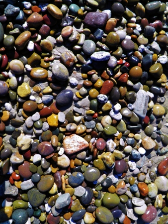 Close up of colorful pebbles on the beach photo