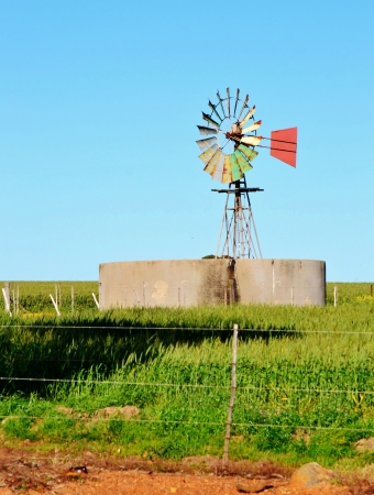 Landscape with windmill water pump on a farm westerncape south africa photo