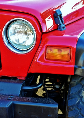 dirtroad: Details of a bright red 4x4 Stock Photo
