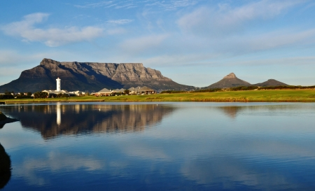 Landscape of Milnerton lagoon with Lighthouse and table mountain in the background photo