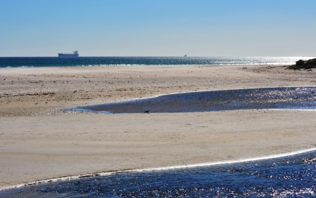 Landscape with view over Milnerton Lagoon to the Atlantic Ocean photo