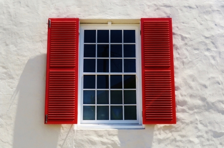 red shutters: Close up of bay window with red shutters Stock Photo