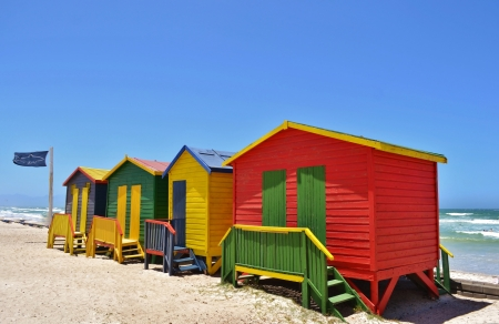 Landscape with colorful changing huts on a beach in Muizenberg photo