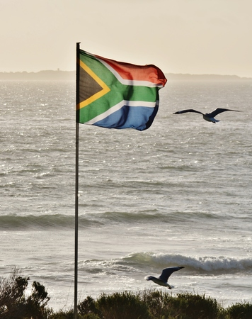 robben island: Close up of South African flag and Seagulls Stock Photo