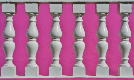 balustrades: Close up of white Precast Balustrades with pink house wall