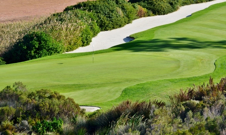 Landscape with putting green and sand bunkers photo