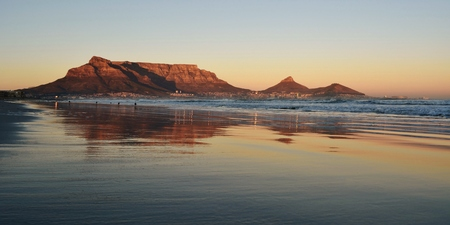 Seascape with Table mountain at sunrise photo