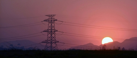 power lines: Landscape with power lines at sunrise Stock Photo
