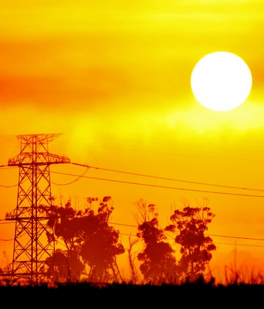 power lines: Landscape with Power lines and beautiful orange sunrise
