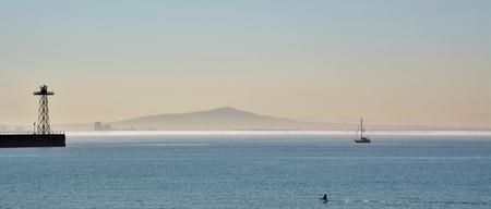 atlantic ocean: Seascape  with Atlantic Ocean and boat in sunlight