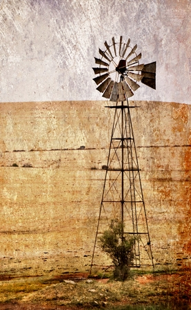 farm land: Landscape with windmill water pump on farm land