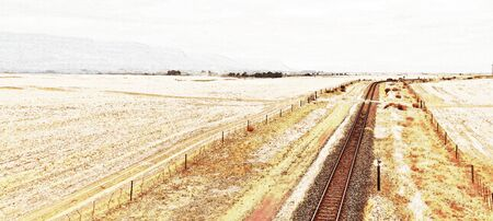 Landscape with dry farm land and a railway line