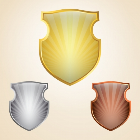 Set of golden, silver and bronze shields Vector