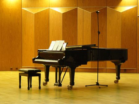 Piano and opened notes in concert hall