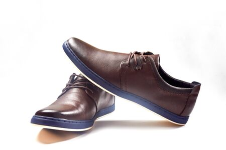 Men fashion brown shoe leather over white background. Pair casual stylish footwear. Close up