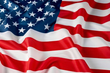 Close up of ruffled American flag. Satin texture curved flag of USA. Memorial Day or 4th of July. Banner and freedom concept