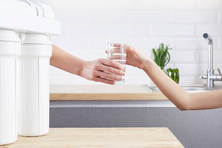 Female Hand giving a glass of clean water. Purified water and a healthy life concept. Stock fotó