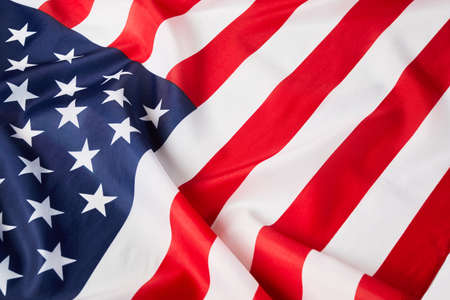 Close up of ruffled American flag. Satin texture curved flag of USA. Memorial Day or 4th of July. Banner