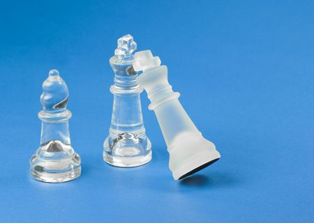 Chess pieces on blue background made of glass