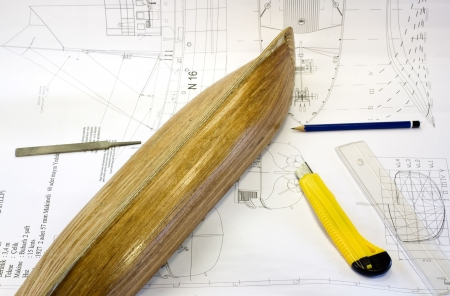 wooden scale model of a ship on plan with tools