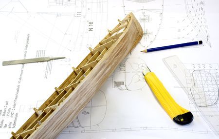 wooden scale model of a ship on plan