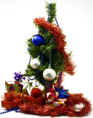 Xmas tree and gift packages on white