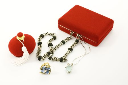 Set of jewels and red jewel box on white