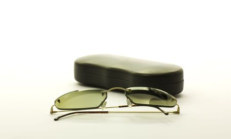Eyeglass and black cover on white background