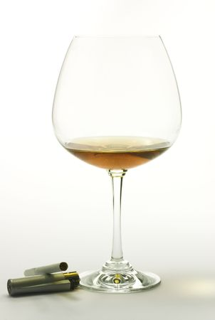 Brandy and cigatrette on white background Stock Photo