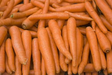 Organic and fresh carrots in a marketplace