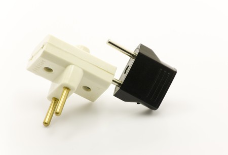 Two electric plugs in each other Stock Photo