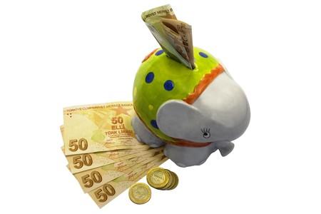 Happy elephant shaped moneybox isolated on white