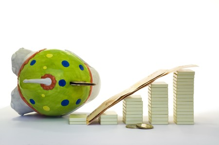 Chart of financial crisis and fallen moneybox Stock Photo
