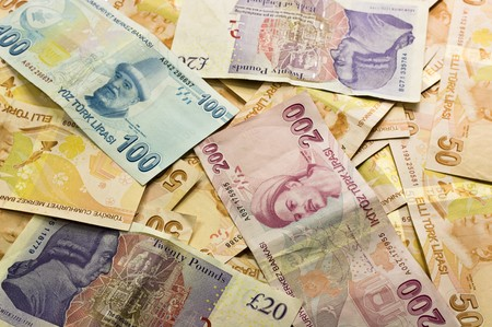 Background of banknotes in different currencies