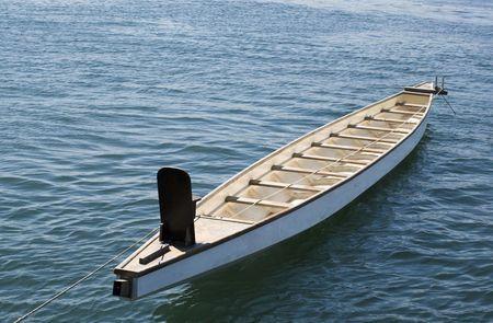 Empty rowboat on the sea