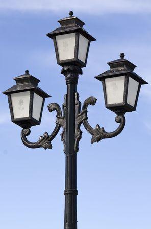 Three bulbs lamppost over the blue sky