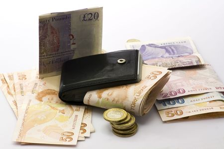 Banknotes and coins next to wallet