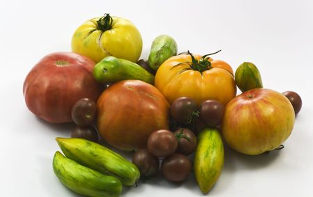 Multicolored organic tomatoes on white Stock Photo