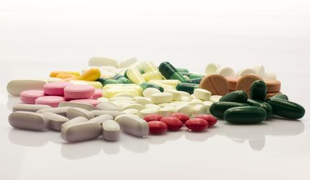 Colorful and different pills over wihte background