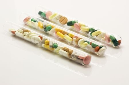 Paralel placed test tubes full of pills Stock Photo
